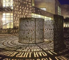 Title: A Comma, A, 2004  Location: Plaza in front of the new library, University of Houston, Houston, TX  Materials: Copper, international language texts, light, black granite paving inlay   Size: 6'x26'x80'