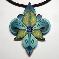 Lynne Ann Schwarzenberg-  cute fleur-de-lis necklace