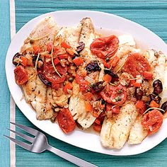 Fish fillets cooked in a tomato-wine sauce are the main attraction for a healthy 30-minute meal.