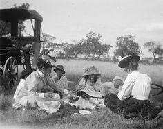 Two women with four children enjoying a picnic ca. 1910