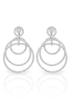 Stylish women want beautiful earrings to wear for their most important events, pull your hair back in that romantic loose side bun you have been dreaming of and don these sparkling 18K and white diamond stunners. Pair with a simple diamond rivera necklace and delicate diamond bracelet from our collection and you will be a stunning vision! Wedding or black tie function, these earrings are a modern and sophisticated choice!