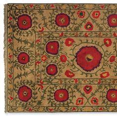 field of poppies handknotted rug $895-$3495 Tibetan rug weavers—refugees living in Kathmandu, Nepal—translate Utah-born designer Kim Whitesides' vibrant design into a plush rug hand-knotted of Tibetan wool on a cotton warp; 60 knots per square inch.