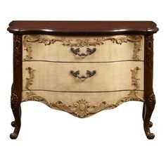 Like antique French originals, this decorative chest will breathe a whole new life into your home. Our chest is so voluptuous, curvy, and ornamental you'd think Louis XIV might request one for Versailles. The antiqued Maren finish emulates painted linen.Gilt rubbed acanthus scrolling and cabochons flow down the drawers and across the cabinet. Classic French drawer pulls and a high cabriole leg complete the classic style. It features two extra wide drawers.