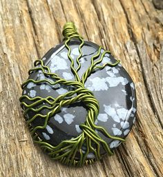 Green tree of life on a snowflake obsidian