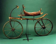 """Draisine, ca. 1818  This week's Smithsonian Snapshot celebrates National Bike Month with the forerunner of the modern bicycle: this ca. 1818 draisine.  In 1817, Karl Drais, a young inventor in Baden, Germany, designed and built a two-wheeled, wooden vehicle that was straddled and propelled by walking swiftly. Drais called it the laufmaschine or """"running machine.""""  (More info here)"""