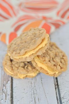 The most delicious oatmeal cookie ever filled with pumpkin cream cheese frosting. Absolutely the best fall cookie ever!