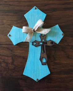 A personal favorite from my Etsy shop https://www.etsy.com/listing/469229702/9-x-12-teal-wooden-cross
