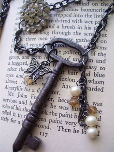 Vintage skeleton key necklace with rhineston button, butterfly charm, and more of my grandmother's buttons | DuctTapeAndDenim.com