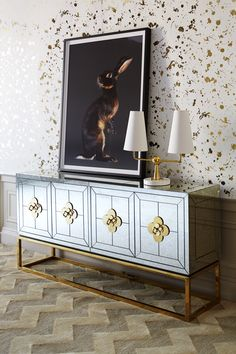 Mirrors are like a decorator's magic wand—they double your space instantly. Our Delphine Collection has the same effect. Featuring the Jonathan Adler Delphine Credenza.