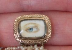 mourning jewelry with photo of deceased person's eye...