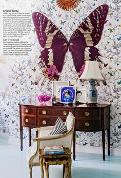 Schumacher's Birds and Butterflies wallpaper, found objects, and her grandmother's sideboard mingle in Chassie Post's apartment. Photo by Matthew Williams for Living etc Magazine.