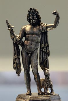 A silver statue of the Roman god Jupiter holding a thunderbolt. His left hand would have grasped a scepter. At his feet is a goat. Greek Olympians, Epic Costumes, Hidden Mystery, Roman Gods, Roman Art, Roman Mythology, Bear Art, God Of War, Ancient Rome