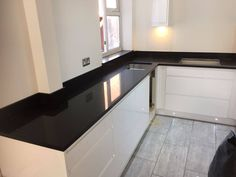 Another installation of our popular Black Quartz with mirror fleck, installed in Hertford. See the product here: Nero Stella Get a quote now: Quote me Quartz Rock, Black Quartz, Kitchen Worktop, Kitchen Cabinets, Granite, Worktop Ideas, Kitchen Ideas, Urban, Mirror