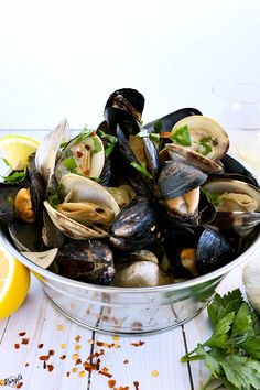 Clams and Mussels in Garlic Butter White Wine Sauce just screams summer. The shellfish are steamed open in a light and incredibly flavorful broth of garlic, butter, wine. Finish with lemon and fresh parsley for a beautiful meal Clam Recipes, Seafood Recipes, Seafood Dinner, Fish And Seafood, Seafood Market, Kitchen Recipes, Cooking Recipes, Healthy Recipes, Asian Recipes