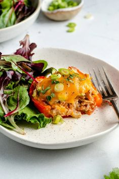 Flavorful low carb tuna stuffed peppers mixed with veggies, greek yogurt & buffalo sauce and topped with layers of melted cheese! These easy tuna stuffed bell peppers make the perfect lunch paired with your favorite sides or even a protein packed, post workout snack. #tuna #lowcarb #healthylunch #healthydinner #glutenfree #grainfree