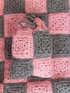 #crochet baby blanket with checkers inside of pouch