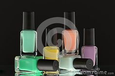 Nail polish bottles on black background