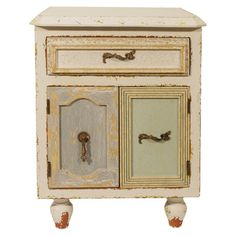 Antiqued wood side table with one drawer and two doors.  Product: Side tableConstruction Material: Wood...
