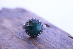 A personal favorite from my Etsy shop https://www.etsy.com/listing/519697661/emerald-green-sterling-silver-ring