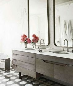 So many things to like about this . . . Flush panel, limed oak cabinetry with white countertops; over scaled mirrors in limed oak finish with chamfered corners and a monochromatic color palette.