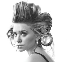 """Brings me back to the 70's when the """"new curlers"""" were pop cans, juice cans or whatever giant round, anything cylinder shaped was the way to do the big hair thing.  I think the twins are sweet no matter what the media wants to label them."""