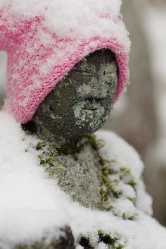 Jizo statue (Ksitigarbha) in snow, Japan