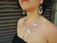 Check out this item in my Etsy shop https://www.etsy.com/listing/40569226/statement-necklace-bib-necklace-bib