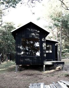 Tiny prefab wooden cabin with sauna and bedroom/living room perfect for two! Inspired by local fishing huts on the island of Trosso, Sweden by Septembre.