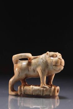 Japanese Carved Netsuke; Cat standing on a bamboo segment, late 19th/early 20th century period, bearing artist's signature to the base. Size; Length of carving is 2 inches with height of 1 3/8 inches. Condition Report; Good condition.