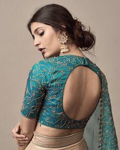 While selecting your desired bridal lehenga, don't forget to pick a stylish blouse design that will compliment your whole look. Indian Blouse Designs, Brocade Blouse Designs, Saree Jacket Designs, Choli Blouse Design, Blouse Designs High Neck, Designer Blouse Patterns, Fancy Blouse Designs, Bridal Blouse Designs, Latest Blouse Designs