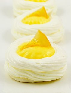 Zingy lemon curd filled Meringue Nests. Perfect mini dessert for Bridal Shower dessert table. Find Meringue Nests and other Mini Desserts at Grace's Sweet Life.