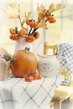 Country Fall. I love the blue and white cloth with the beautiful fall oranges.