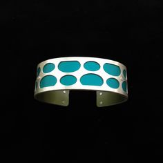 Handmade from sterling silver and anodized aluminum. #ilovegogojewelry #ovals #cuff