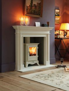 Chesney's Beaumont stove in ivory with Burlington limestone surround.  Stone Shop would love to duplicate this for you!