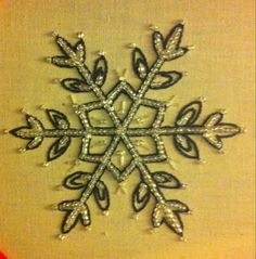I know it's a little out of season but, I was inspired by the movie Frozen to make this little snowflake here. This project took me ages days to complete. I used a simple split stitch ( my favorite by far) to outline the snowflake and filled it in with glass beads.