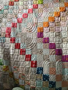 The quilting close up. Stitched quilt designs.