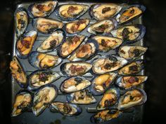 baked mussles with tamarind seasoning, soysauce, crispy shallot, scallion and a little butter and olive oil... season to your own liking
