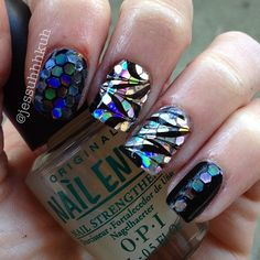 Water marble over hand placed holo glitter + jelly sandwich nail art design