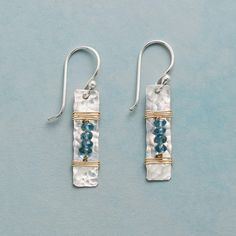 """THE BEADS BETWEEN EARRINGS--London blue topaz align between coils of 14kt gold filled wire on a hammered sterling silver tab. French wires. Handmade in USA. Exclusive. 1-3/8""""L."""