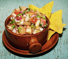 Chifrijo. it's like bean dip and pico de gallo with fried pork pieces in it.