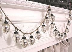 Love this silver mercury glass ornament garland using twine!