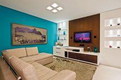 sala de tv com sofa em l
