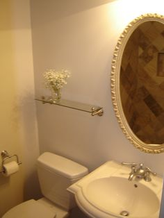 The full second bathroom is newly renovated, with mosaic tile floor, a Kohler pedestal sink and Toto toilet. There is a glass shelf for toiletries and a full walk in shower, pictured separately. Toto Toilet, Florida Sunshine, Condo Interior, Pedestal Sink, Walk In Shower, Glass Shelves, Mosaic Tiles, Tile Floor, Shelf