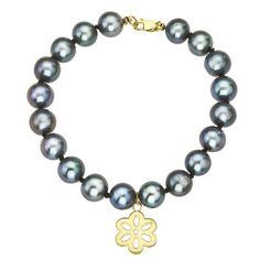 Black Pearls bracelet with a dangling 14k Yellow gold diamond Flower charm -