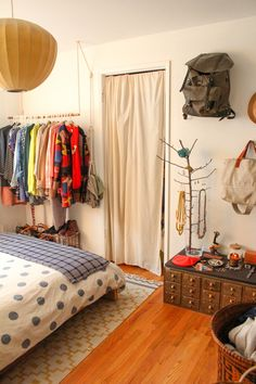 >>> travelers. suspended clothing rack and backpacks. | The Duplex, Right Side: Jean & Dylan's Playful, Working Hideaway