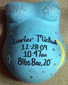 Stars and moon decorated belly cast with birth announcement on it. Beautiful!