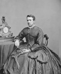 """Late 1800s: The etymology of the phrase """"drag queen"""" is debatable, but many scholars believe that the phrase was coined in the 1800s as a reference to the hoop skirt. As seen in this photo, hoop skirts would """"drag"""" along the ground."""