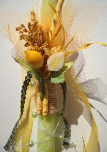 Greek Easter candle (lambada) in lemon and green colors.