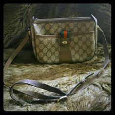 """Authenic vintage GG pattern gucci crossbody bag 100% authentic vintage gucci cross body bag  Inside tag reads """"GUCCI Accessory Collection""""  This bag is from the early 80's .. 1982 to be exact.  # 09.02.032  Normal wear due to its age:   -  peeling on the leather. -  2 interior holes on the small front pocket fabric.  - light scraches on metal   It may have some small flaws but the canvas is still beautiful.  Size (Inch) W 8.3 """" H 6.5 """" D 3.3 """"  Shoulder Drop. 19.7 - 21.3 """" Bundle and save…"""