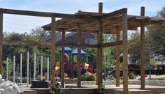 You need to visit the Wilson Spark Park... it is awesome.  Playground, sand hills, castle, pergola, outdoor classroom & chalkboard and lots of logs for climbing!